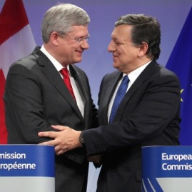 Prime Minister Stephen Harper and European Commission President Jose Manuel Barroso shaking hands after signing Canada-EU Free Trade Agreement on Friday 18, October 2013 at the European Commission in Brussels, Belgium.